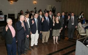 The 2004 company and firematic officers took their oaths during the annual dinner.