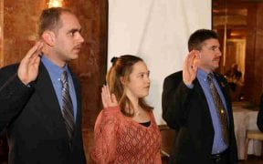 The 2006 company and firematic officers took their oaths during the annual dinner on February 25, 2006. (Photos by Paul F. Harrington)