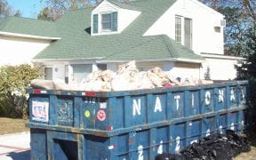 Dumpsters couldn't hold all the destroyed property inside the houses that were flooded.