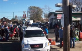People stood in line for hours at gas stations waiting to fill gas containers.