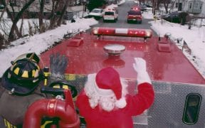 On Sunday, December 21st, 2003, Operation Santa Claus went into action. Members of Good-Will escorted Santa through the district to visit all of the children and pass out hundreds of candy canes. With lights flashing and sirens blaring, the convoy of emergency vehicles made stops at the local residences as well as Price Chopper and Home Depot. Santa Claus rode atop Engine 312, escorted by two firefighters. Upon returning to the firehouse, Santa then dropped in to visit the friends and relatives of Good-Will members during the annual Christmas party. (Photos by F/F Paul Harrington)