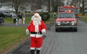 On Sunday, December 19th, 2004, members of Good-Will escorted Santa Claus through the district to visit all of the children and pass out hundreds of candy canes. With lights flashing and sirens blaring, the convoy of emergency vehicles made stops at the local residences as well as Price Chopper and Home Depot. Santa then visited the friends and relatives of Good-Will members during the annual Christmas party.  The first image is a scanned copy of Page 1 of the Mid-Hudson Times published on Wednesday, December 22nd, 2004. (Photos by Paul F. Harrington)
